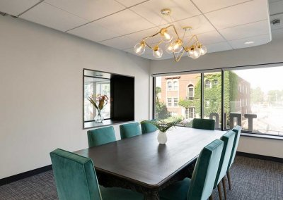 Photo of a board table in a bright conference room