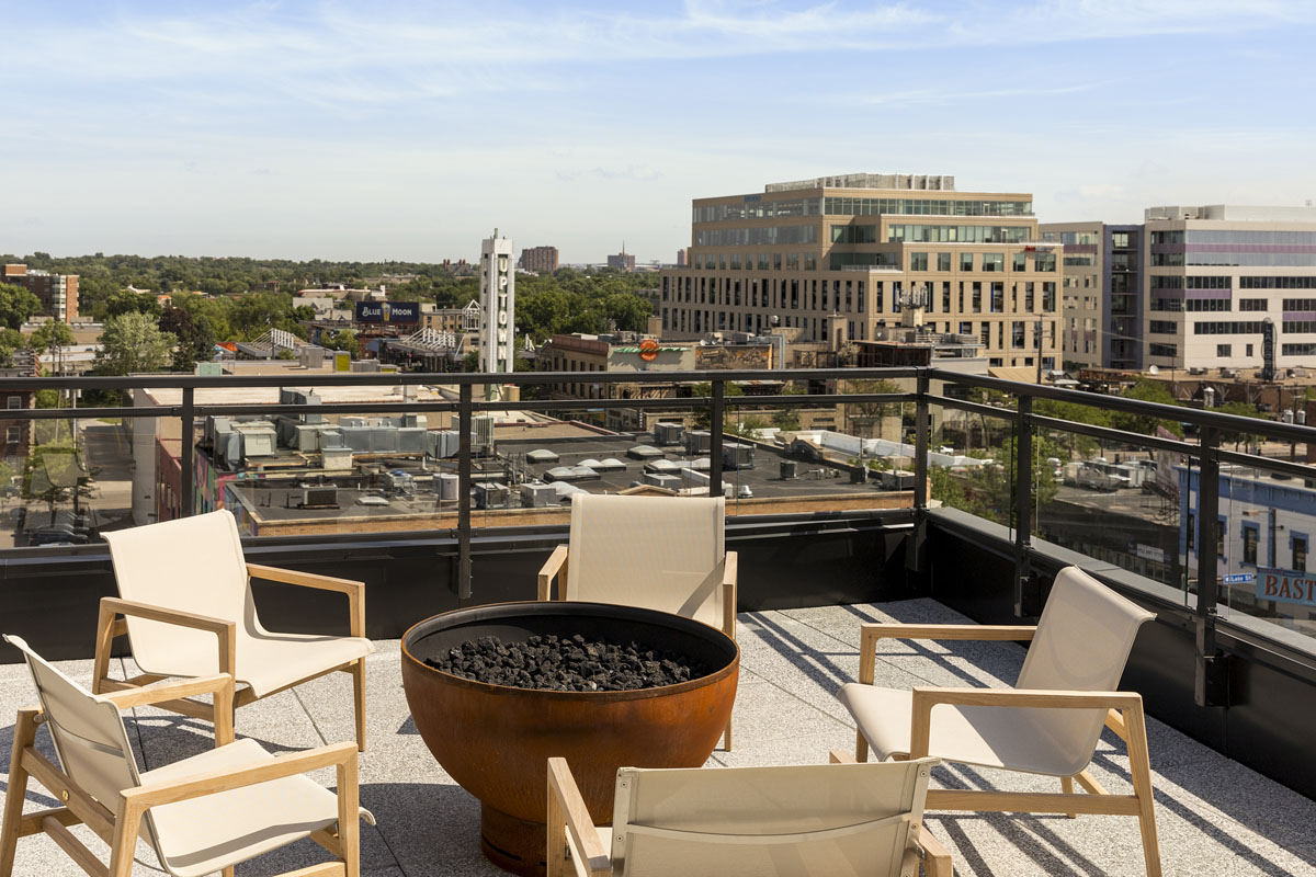 Rooftop entertainment area fire pit and beautiful views of Uptown neighborhood