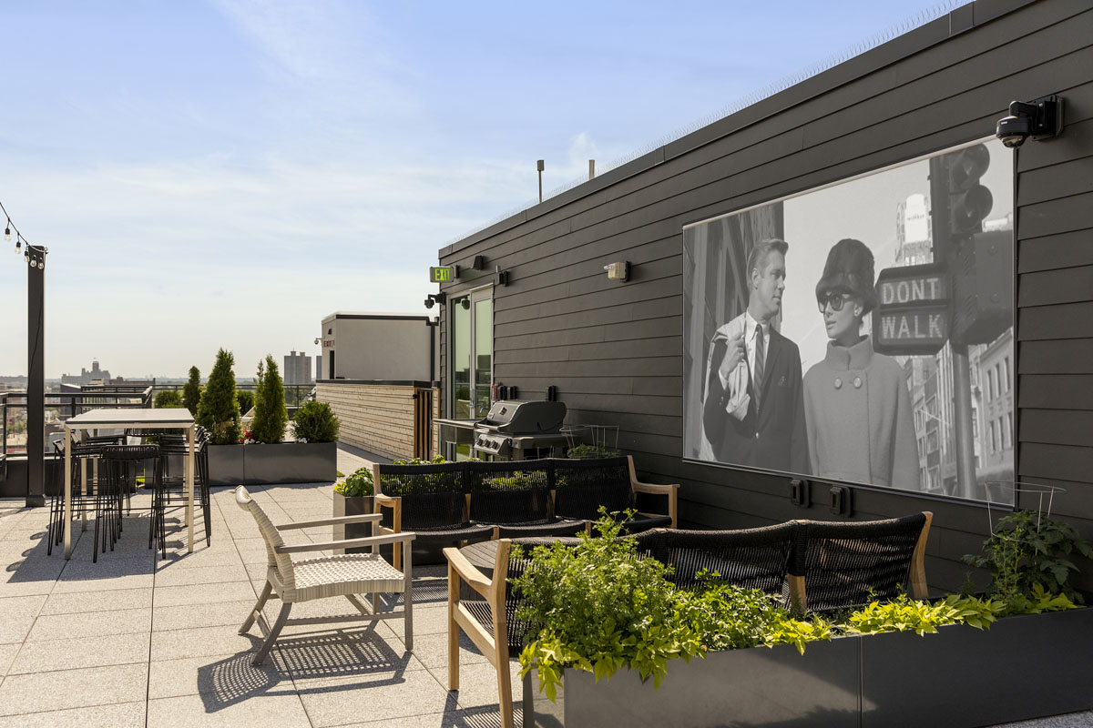 View of rooftop entertainment area showing movie screen and seating