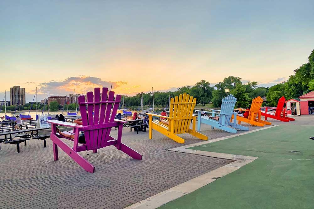 An art installation of brightly colored adirondak chairs at Lake Bde Maka Ska, Minneapolis