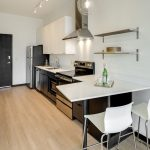 View of open-concept kitchen with counter peninsula