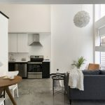 view of lower level of loft apartment with open concept kitchen and living room