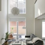 view of lower level of loft apartment living room and exterior door