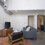 View of lower floor of loft apartment open-concept living room
