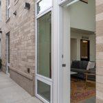 Exterior of Tūla apartment building with open side door